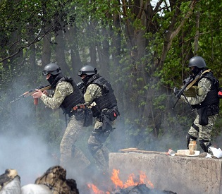 Ukraine forces kill up to five rebels, Putin warns of consequences